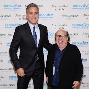 "Actors George Clooney, left, and Danny DeVito attend ""An Evening of SeriousFun Celebrating the Legacy of Paul Newman,"" hosted by the SeriousFun Children's Network at Avery Fisher Hall on Monday, March 2, 2015, in New York. (Photo by Evan Agostini/Invision/AP)"