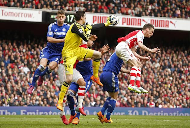 Football: Chelsea's Thibaut Courtois and Gary Cahill in action with Arsenal's Laurent Koscielny