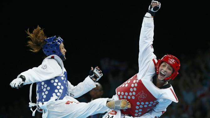 Britain's Jade Jones celebrates as she wins against Taiwan's Li-Cheng Tseng in their women's -57kg semifinal taekwondo match at the London Olympic Games