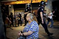 Riot policemen patrol in Madrid after a protest against the Spanish government's latest austerity measures, on July 19, 2012. Riot police have charged protestors in Madrid, striking them with batons when they tried to reach the heavily-guarded parliament building