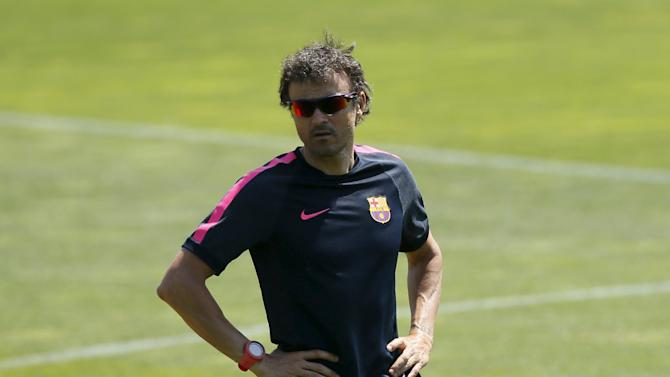 Barcelona's coach Luis Enrique attends a training session during the media Barcelona Open Day in Spain
