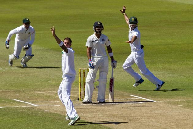 South Africa's de Villiers, Steyn and Duminy appeal successfully for the wicket of India's Kholi during the fifth day of the second cricket test match in Durban
