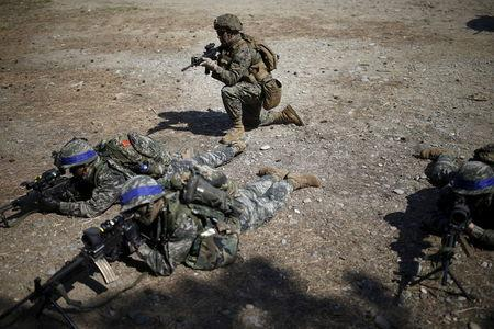 South Korean and U.S. Marines take up their positions during a U.S.-South Korea joint landing operation drill in Pohang