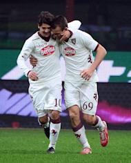Torino's forward Riccardo Meggiorini (R) celebrates after scoring his second goal during the serie A match between Inter Milan and Torino on January 27, 2013 at the San Siro stadium in Milan. The match ended in a 2-2 draw