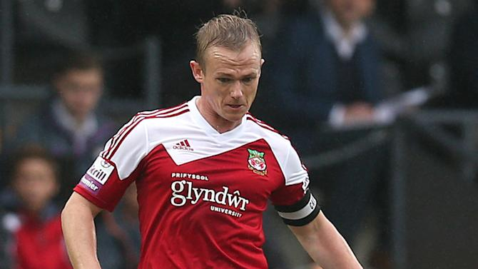 Wrexham boss Keates punches assistant during first match in charge
