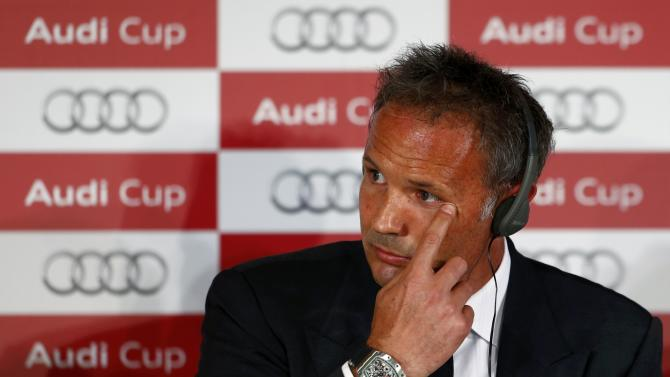 Coach Mihajlovic of AC Milan reacts during a news conference on the eve of the pre-season Audi Cup tournament, in Munich
