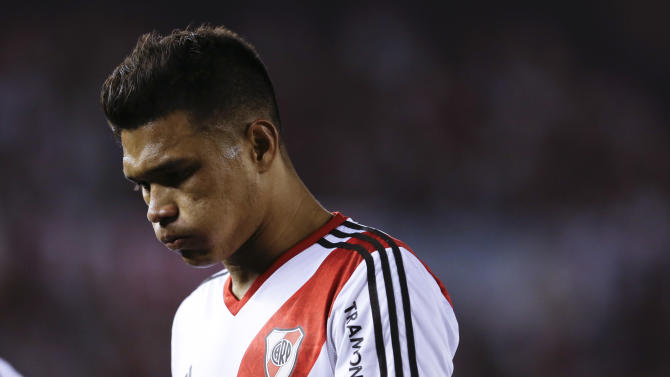 River Plate's Teofilo Gutierrez leaves the field after an Argentina's league soccer match  against Boca Juniors in Buenos Aires, Argentina, Sunday, Oct. 6, 2013. River Plate lost 0-1