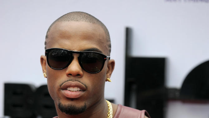 B.o.B arrives at the BET Awards at the Nokia Theatre on Sunday, June 30, 2013, in Los Angeles. (Photo by Chris Pizzello/Invision/AP)
