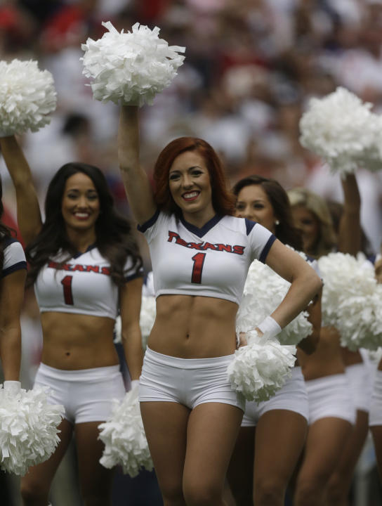 The Houston Texans' Cheerleaders perform before an NFL football game Sunday, Sept. 7, 2014, in Houston. (AP Photo/Patric Schneider)