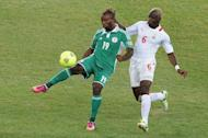 Nigeria forward Sunday Mba (left) is challenged by Burkina Faso midfielder Djakaridja Kone during the 2013 Africa Cup of Nations final on February 10, 2013 at Soccer City stadium in Johannesburg. A first-half goal from Mba saw Nigeria to a third Africa Cup of Nations title as they beat Burkina Faso 1-0