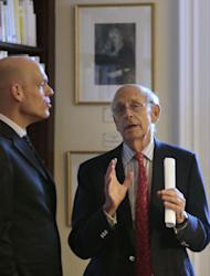 United States Supreme Court Justice Stephen Breyer, right, speaks with Harvard professor Holger Spamann, left, at the French Cultural Center, Monday, Feb. 13, 2017, in Boston, while touring the center before participating in a forum called From the Bench to the Sketchbook. (AP Photo/Steven Senne)