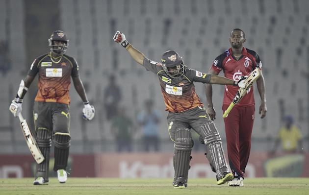 SRH batsman Thisara Perera and KV Sharma celebrates win during the CLT20 match between Trinidad & Tobago and Sunrisers Hyderabad at Mohali, Chandigarh on Sept. 24, 2013. (Photo: IANS)