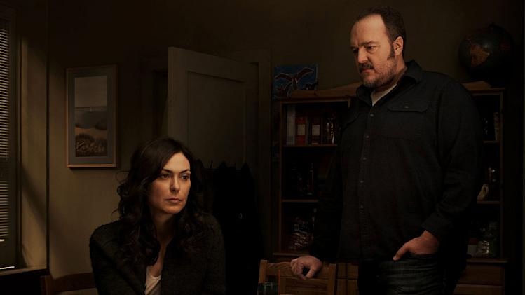 "Michelle Forbes as Mitch Larson and Brent Sexton as Stan Larson in ""The Killing."""