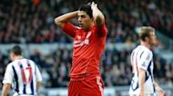 Liverpool's Uruguayan forward Luis Suarez reacts after missing an opportunity to score during the English Premier League football match between Liverpool and West Bromwich Albion at Anfield in Liverpool. West Brom won 1-0