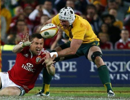 British and Irish Lions' Tommy Bowe struggles for control of the ball against Australia Wallabies' Ben Mowen during their third and final rugby union test match at ANZ stadium in Sydney