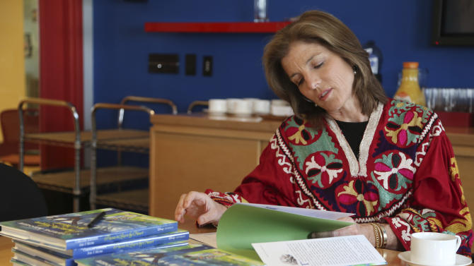 "In this Tuesday, March 26, 2013 photo, Caroline Kennedy flips through her new book ""Poems to Learn by Heart"" during an interview with The Associated Press in New York. Kennedy's 10th and latest book extols the value of learning poems by heart. (AP Photo/Mary Altaffer)"
