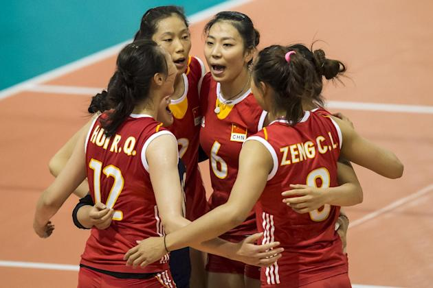 Cina's volleyball team players celebrate a point against Brazil during their game at the Montreux Volleyball Masters women tournament, being hosted in Montreux, Switzerland, Wednesday, May 28, 201