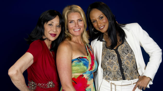 """This July 18, 2012 photo shows models China Machado, lfrom left, Kim Alexis and Beverly Johnson in New York. The models appear in a new documentary called """"About Face"""" premiering on HBO on July 30. The film looks at topics like each model's career, aging and our culture's obsession with youth. (Photo by Charles Sykes/Invision/AP)"""