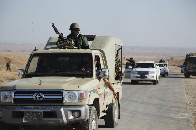 Members of the Kurdish security forces ride in vehicles during an intensive security deployment in Diyala province north of Baghdad November 19, 2014. Iraqi armed forces backed by the Kurdish peshmerga launched an attack on November 19 to liberate Sadiya town, in Diyala province, east of the Iraqi capital Baghdad. Picture taken November 19, 2014. REUTERS/Stringer (IRAQ - Tags: CIVIL UNREST POLITICS MILITARY)