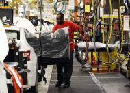 In this April 6, 2016, photograph, a technician uses a lift to move a back seat bench into a new Altima on the assembly line at the Nissan Canton Vehicle Assembly Plant in Canton, Miss. On Wednesday, Feb. 15, 2017, the Federal Reserve reports on U.S. industrial production for January. (AP Photo/Rogelio V. Solis)