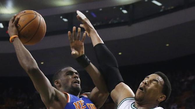 New York Knicks guard Tim Hardaway Jr. (5) shoots against Boston Celtics center Jared Sullinger (7) during the second half of an NBA basketball game in Boston, Wednesday, March 12, 2014. The Knicks won 116-92