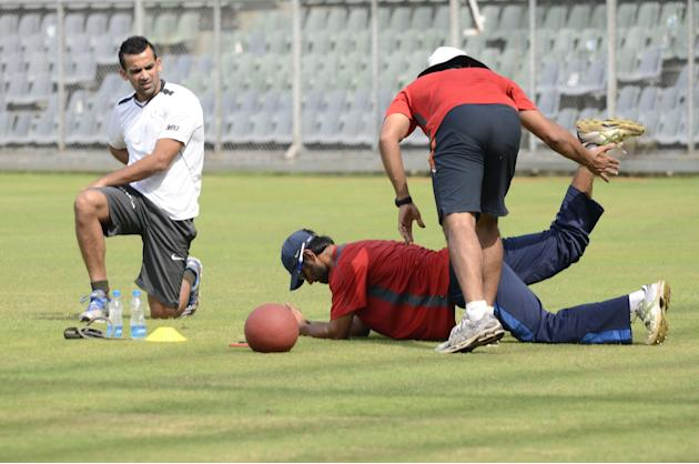 Mumbai captain Zaheer Khan practices with his team ahead of Ranji Trophy match against Haryana in Lahli, Rohtak in Mumbai on Oct.24, 2013. (Photo: Sandeep Mahankaal/IANS)