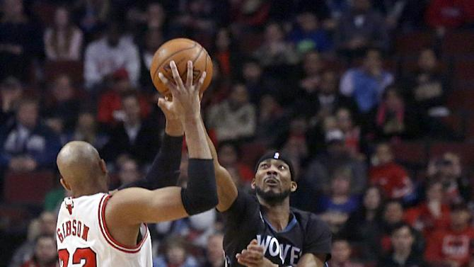 Minnesota Timberwolves forward Corey Brewer, right block a pass by Chicago Bulls forward Taj Gibson (22) during the first half of an NBA basketball game, Monday, Jan. 27, 2014, in Chicago