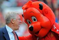 Manchester United manager Sir Alex Ferguson talks to club mascot Fred the Red at a game in 2011. The defining plot twist of the most enthralling title race in years could be written on Monday as City attempt to seize control of their Premier League destiny against leaders United