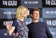 """Tom Cruise and British actress Rosamund Pike at a press conference for their movie """"Jack Reacher"""" in Seoul on January 10, 2013. Cruise turned down a chance to try out his """"Gangnam Style"""" dance skills, despite topping South Korean rapper Psy's list of celebrities who should attempt the signature horse-riding dance"""