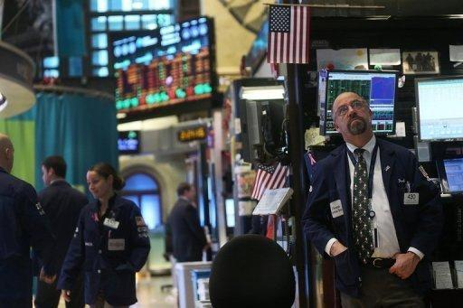Traders work on the floor of the New York Stock Exchange on December 12, 2012. InterContinentalExchange (ICE) would have to pay NYSE Euronext $750 million if their merger is blocked by regulatory or competition authorities, according to an SEC filing published.