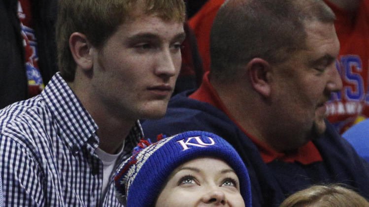 "Actress Olivia Wilde looks at the scoreboard during the second half of an NCAA college basketball game between Kansas and Howard in Lawrence, Kan., Thursday, Dec. 29, 2011. Wilde, who appears on TV's ""House,"" starred in the movie ""Tron: Legacy.""  (AP Photo/Orlin Wagner)"