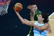 Argentinian forward Luis Scola (R) shoots during the Men's Preliminary Round Group A basketball match Argentina vs Lithuania at the London 2012 Olympic Games. Scola scored 32 points and Manu Ginobili added 21 to lead Argentina's victory over Lithuania. They are among five players on the South American squad who won 2004 Olympic gold