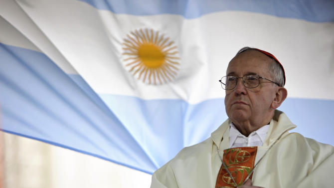 FILE - In this Aug. 7, 2009 file photo, Argentina's Cardinal Jorge Bergoglio gives a Mass outside the San Cayetano church where an Argentine flag hangs behind in Buenos Aires, Argentina. On Wednesday, March 13, 2013, Bergoglio was elected pope, the first ever from the Americas and the first from outside Europe in more than a millennium. He chose the name Pope Francis. (AP Photo/Natacha Pisarenko)