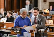 In this Jan. 25, 2017 photo, state Sen. Ernie Chambers, left, of Omaha, goes over documents with Sen. Adam Morfeld of Lincoln, in Lincoln, Neb. Thirty days after they convened, Nebraska lawmakers are still spinning their wheels over parliamentary rules in what's shaping up to be one of the least productive legislative sessions in state history. Lawmakers on Wednesday, Feb. 15, 2017, will have burned through one-third of the days available for debate but have only passed two bills so far. (AP Photo/Nati Harnik)