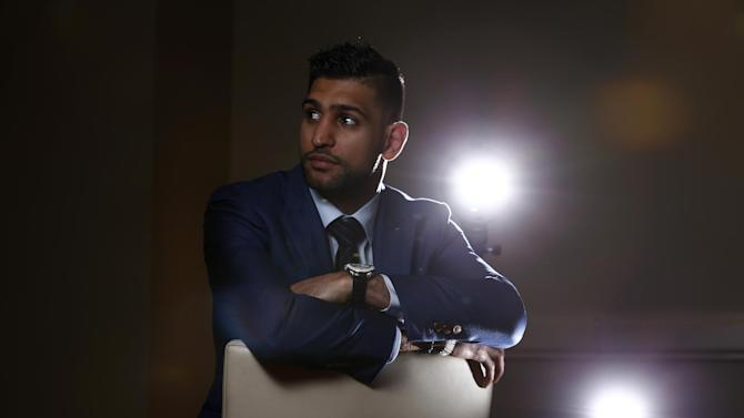 Amir Khan poses before the press conference