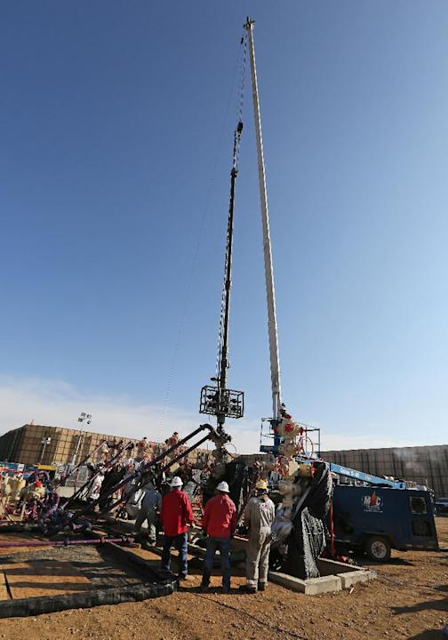 In this March 25, 2014 photo, perforating tools, used to create fractures in the rock, are lowered into one of six wells during a roughly two-week hydraulic fracturing operation at an Encana Corp. wel