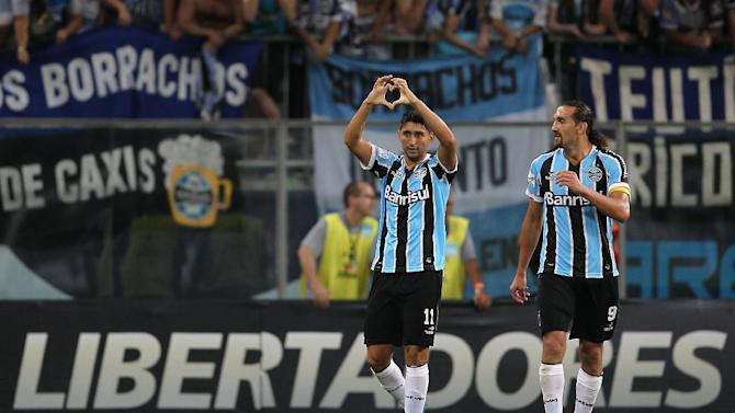 Alan Ruiz of Brazil's Gremio, left, celebrates his goal accompanied with teammate Hernan Barcos during their game against Colombia's Atletico Nacional during a Copa Libertadores soccer game in Porto Alegre, Brazil, Tuesday, Feb.25, 2014. Gremio won 3-0