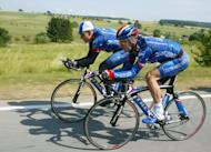 "Lance Armstrong (L) and Floyd Landis ride on the eve of the prologue of the 89th Tour de France, on July 5, 2002. Seeking ""tens of millions"" paid to Armstrong for ""years of broken promises"", the US government has joined a lawsuit alleging the doping cyclist defrauded former sponsor US Postal Service"