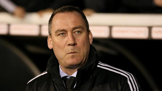 """In this file photo dated Tuesday, Feb. 4, 2014, Fulham's soccer club manager Rene Meulensteen looks out from the technical area prior to their 4th round replay English FA Cup soccer match between Fulham and Sheffield United at Craven Cottage stadium in London.  Fulham fired manager Rene Meulensteen and appointed German coach Felix Magath on Friday Feb. 14, 2014, saying """"action was required"""" in its bid to avoid relegation from the English Premier League"""