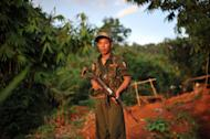An All Burma Students Democratic Front soldier, an ally of the Kachin Independence Army (KIA), stands guard at an outpost on the Laja Yang frontline, in Myanmar's northern Kachin state on September 22, 2012