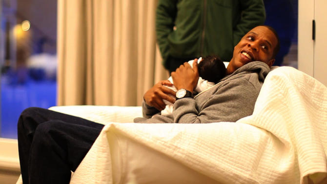 "In this undated image released by Beyonce.com, rapper Jay-Z holds his daughter with singer-wife Beyonce Knowles, Blue Ivy in a recent family photo. Photos of the 1-month-old were posted by her parents on Tumblr blog page https://ec.yimg.com/ec?url=http%3a%2f%2fhelloblueivycarter.tumblr.com.&t=1429481010&sig=Bzz2BA4w3QXXrWv_WsmQAQ--~B A hand-written note accompanying the photos reads, ""We welcome you to share our joy.""  (AP Photo/Ed Burke for Beyonce.com) MANDATORY CREDIT"