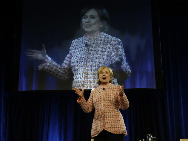 Former Secretary of State Hillary Rodham Clinton delivers her Simmons College Leadership Conference keynote address at the Seaport World Trade Center Wednesday, April 23, 2014 in Boston. (AP Photo/Ste