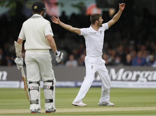 England's Mark Wood celebrates taking the wicket of New Zealand's Corey Anderson during the third day of the first Test match between England and New Zealand at Lord's cricket ground in Lo