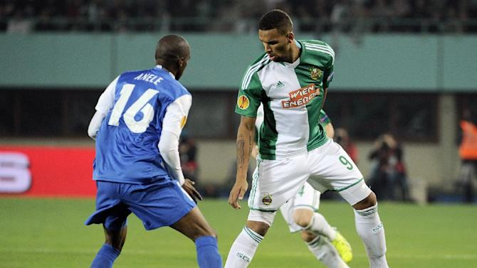 Rapid's Terrence Boyd, right, and Genk's Anele Ngongca challenge for the ball during their Europa League   group G soccer match between SK Rapid Vienna  and KRC Genk, in  Vienna, Austria, Thursday, Nov. 7, 2013