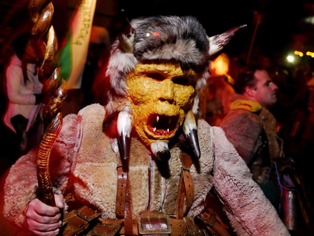 A kukeri from Pernik gestures menacingly at the camera during the opening of the festival. The mask is supposed to protect the wearer from the influence of evil spirits, according to folklore. The tra
