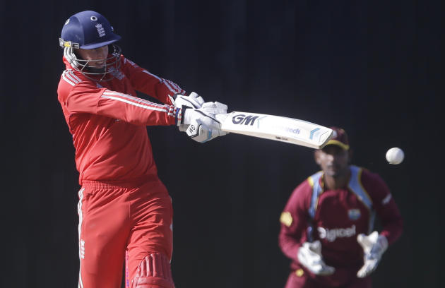 England's Joe Root plays a shot during a one-day international cricket match against West Indies at the Sir Vivian Richards Cricket Ground in St. John's, Antigua, Friday, Feb. 28, 2014. (AP Ph