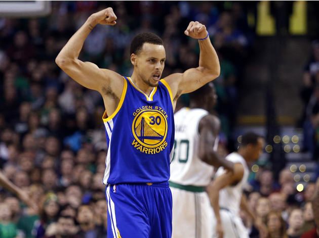 Golden State Warriors' Stephen Curry flexes his muscles after a teammate dunked during the second half of a 106-101 win over the Boston Celtics in an NBA basketball game in Boston, Sunday, March 1