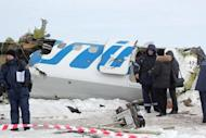 A photo provided on April 2, 2012 by the Russian Emergencies Ministry shows rescuers and investigators working at the site of a plane crash in Siberia that killed 31 people on Monday. The French-Italian made ATR-72 passenger plane run by private Russian airline UTair came down moments after takeoff some 45 km (28 miles) from the western Siberian city of Tyumen