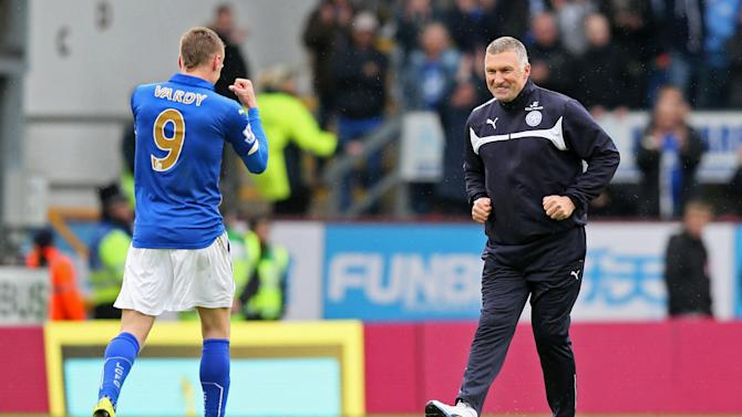 """Football: Football - Burnley v Leicester City - Barclays Premier League - Turf Moor - 25/4/15 Leicester City manager Nigel Pearson celebrates with Jamie Vardy at the end Action Images via Reuters / Paul Currie Livepic EDITORIAL USE ONLY. No use with unauthorized audio, video, data, fixture lists, club/league logos or """"live"""" services. Online in-match use limited to 45 images, no video emulation. No use in betting, games or single club/league/player publications.  Please contact your account representative for further details."""