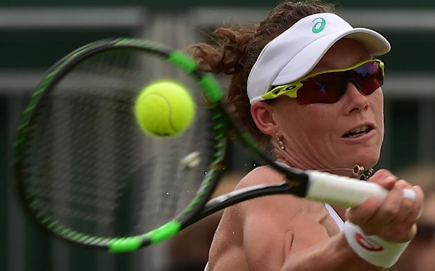 Australia's Samantha Stosur returns during the women's singles second round match of the 2015 Wimbledon Championships at The All England Tennis Club in Wimbledon, southwest London, on July 1,